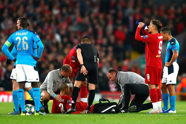 Liverpool's Fabinho receives medical treatment during the match against Napoli. Photo: Getty
