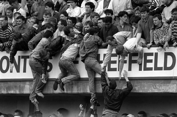 Liverpool fans at Hillsborough, trying to escape severe overcrowding during the FA Cup semi-final football match between Liverpool and Nottingham Forest. PA Photo