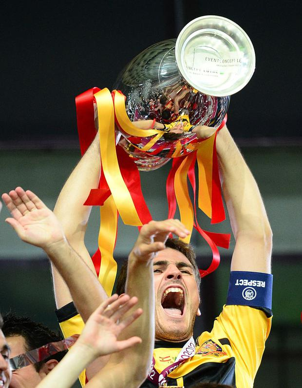 Spanish goalkeeper and captain Iker Casillas holds the trophy and celebrate with team mates after winning the Euro 2012 football championships final match Spain vs Italy on July 1, 2012 at the Olympic Stadium in Kiev. AFP PHOTO / FRANCK FIFE (Photo credit should read FRANCK FIFE/AFP/GettyImages)