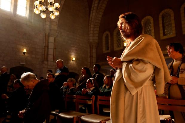 Worship: Mass at the chapel at Notre Dame in Jerusalem yesterday. Photo: Getty Images