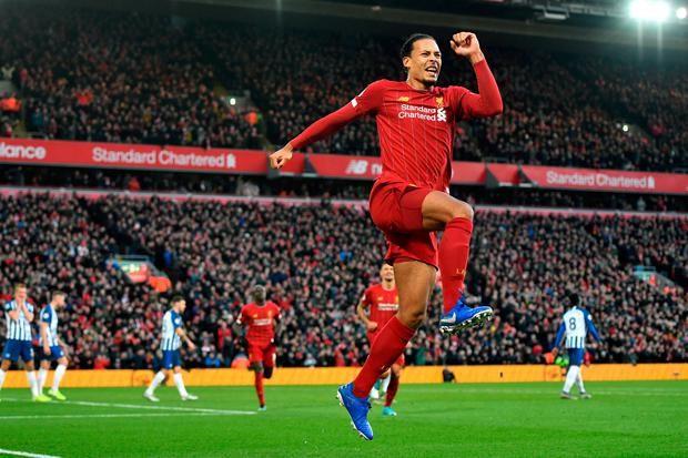 Liverpool's Virgil van Dijk celebrates scoring his second goal during the Premier League win over Brighton at Anfield. Photo: Anthony Devlin/PA Wire