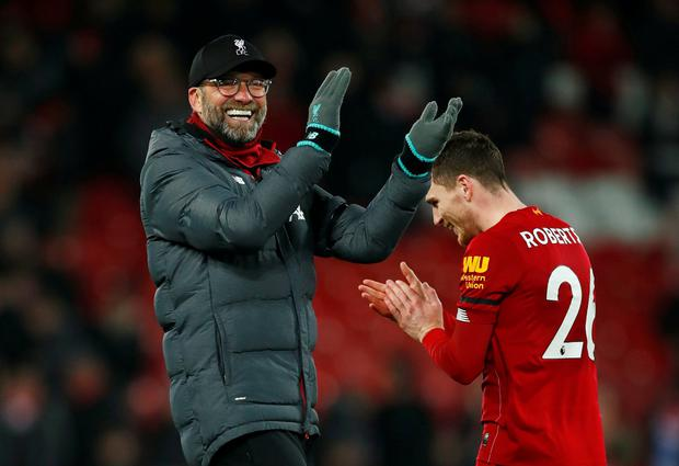 Liverpool manager Jurgen Klopp and Andrew Robertson celebrate after the Premier League win over Brighton. Photo: Reuters/Eddie Keogh