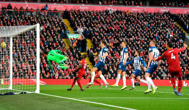 Virgil van Dijk (right) looks on as his header hits the back of the net to give Liverpool the lead. Photo: PA