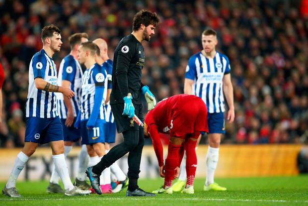 Alisson Becker leaves the pitch after receiving a red card. Photo: Clive Brunskill/Getty Images