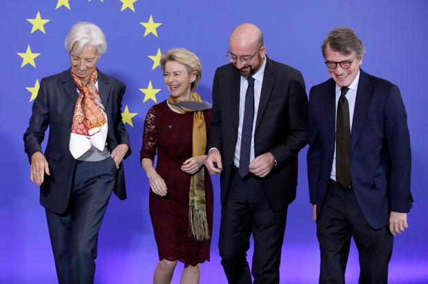 From left, European Central Bank President Christine Lagarde, European Commission President Ursula von der Leyen, European Council President Charles Michel, and European Parliament President Sassoli get ready to pose for photographers as they mark the 10th anniversary of the entry into force of the Lisbon Treaty at the House of European History in Brussels, Sunday, Dec. 1, 2019. (AP Photo/Olivier Matthys)