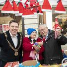 Elfing around: Dublin's Lord Mayor Paul McAuliffe opened the Henry Street/Mary Street Christmas Trading with Cllr Joe Costello and 93-year-old trader Rose Dodrill. Photo: Iain White/Fennell Photography
