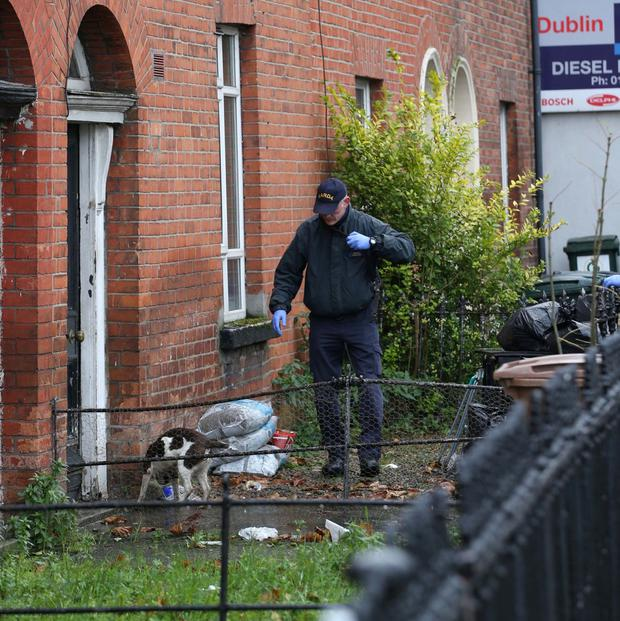 Aftermath: Gardaí preserve the scene after a shooting incident on North Strand Road. Photo: Stephen Collins/Collins Photos
