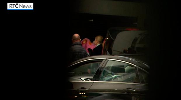 Held in custody: Lisa Smith arrives at a Kevin Street Garda station in Dublin yesterday. Photo: RTÉ News