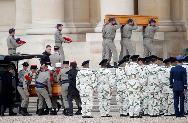 Soldiers carry the coffins of late thirteen French soldiers killed in Mali, before a ceremony at the Hotel National des Invalides in Paris, France, December 2, 2019. REUTERS/Charles Platiau