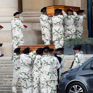Soldiers carry the coffins of late thirteen French soldiers killed in Mali, before a ceremony at the Hotel National des Invalides in Paris, France, December 2, 2019 REUTERS/Charles Platiau