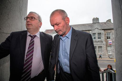 Michael Ferris (right) making his way into Tralee District Court in 2017. Pic:Mark Condren
