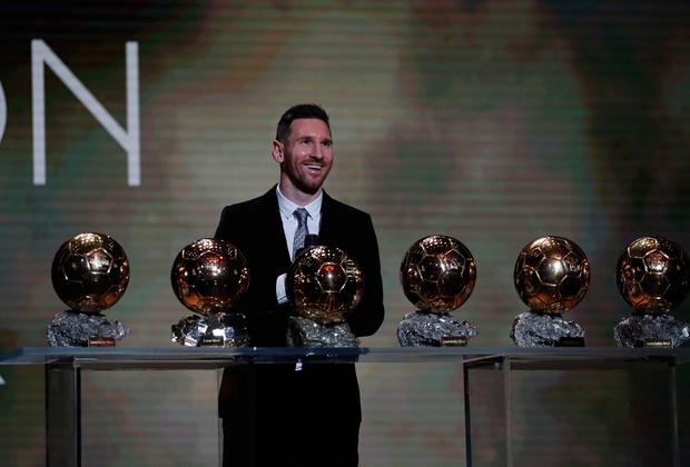 Six of the best: Lionel Messi poses with his awards after winning his sixth Ballon d'Or award in Paris last night. AP Photo/Francois Mori