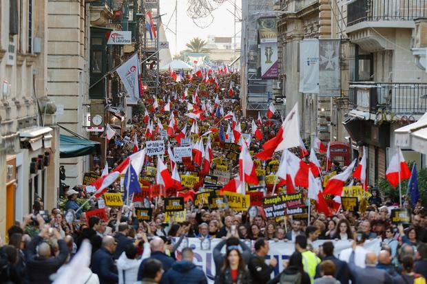 Rally: People gather to call for the resignation of Prime Minister Joseph Muscat in Valletta, Malta, yesterday. Photo: Vincent Kesslerr