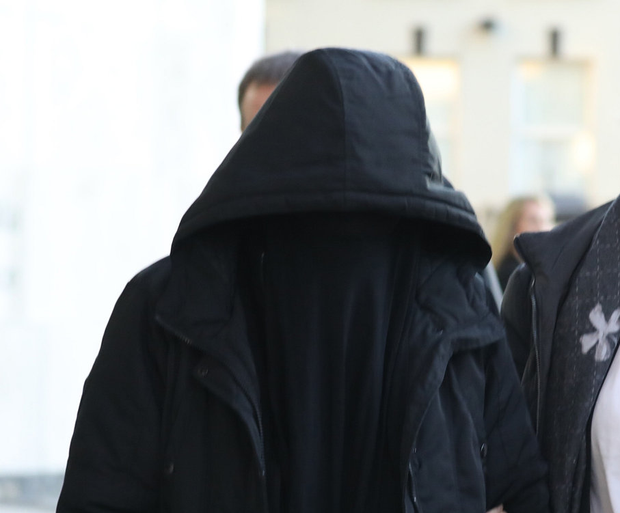 Lisa Smith (38) (covered, escorted by a Garda member, is seen leaving the Criminal Courts of Justice, Dublin). PIC: Collins Courts