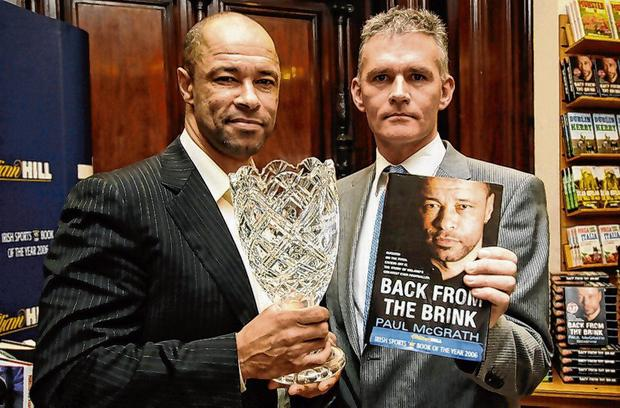 Paul McGrath with Vincent Hogan after his book 'Back from the Brink' won the 2006 William Hill Sports Book of the Year. Photo: Ray McManus / Sportsfile