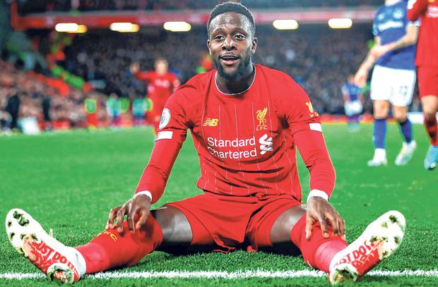 Liverpool striker Divock Origi celebrates after finding the net against Everton for a second time. Photo: Getty