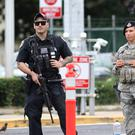 Security stands guard outside the main gate at Joint Base Pearl Harbor-Hickam, in Hawaii, Wednesday, December 4, 2019. Photo: AP Photo/Caleb Jones