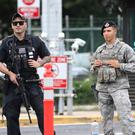 Security stands guard outside the main gate at Joint Base Pearl Harbor-Hickam, in Hawaii (AP Photo/Caleb Jones)