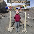 Emotional: Moya Gilligan (16) poses at Stella Point on Mount Kilimanjaro