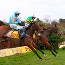 Defi Du Seuil and Barry Geraghty jump the last ahead of Un De Sceaux (Paul Townsend) to win the the TingleCreek Steeple Chase. Photo: Mark Kerton