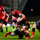 Peter O'Mahony scores Munster's crucial try despite the tackle of Brad Barritt of Saracens at Thomond Park last night. Photo: Diarmuid Greene/Sportsfile