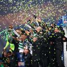 GLASGOW, SCOTLAND - DECEMBER 08: Scott Brown (C) of Celtic lifts the Betfred Cup with his teammates following victory in the Betfred Cup Final between Rangers FC and Celtic FC at Hampden Park on December 08, 2019 in Glasgow, Scotland. (Photo by Michael Steele/Getty Images)