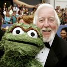 Caroll Spinney, the puppeteer and voice of muppets on TV's Sesame Street poses with