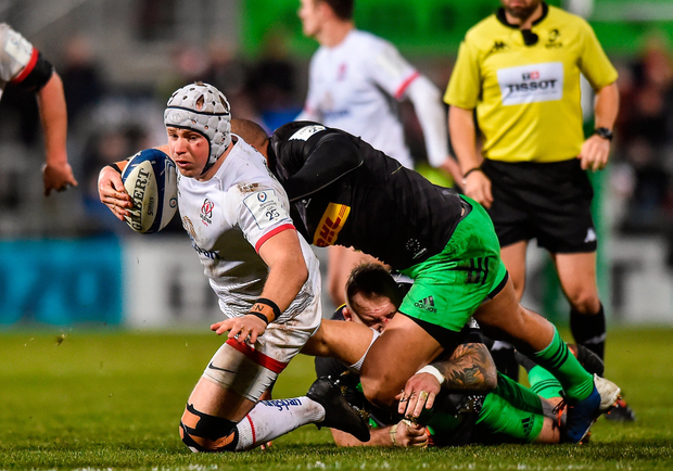 Luke Marshall of Ulster is tackled by Joe Marler of Harlequins. Photo by Oliver McVeigh/Sportsfile