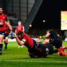 Leading from the front: Munster captain Peter O'Mahony scores the game's only try despite the efforts of Brad Barritt in the victory against Saracens at Thomond Park. Photo by Diarmuid Greene/Sportsfile