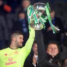 Celtic goalkeeper Fraser Forster (left) and manager Neil Lennon celebrate with the Betfred Scottish Cup after the Betfred Scottish Cup Final at Hampden Park, Glasgow. Photo credit: Jeff Holmes/PA Wire.
