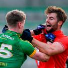 Meath's Mathew Costello and Louth's Dermot Campbell tussle off the ball. Photo: Piaras Ó Mídheach/Sportsfile