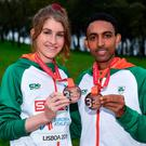 Irish joy: Stephanie Cotter with her individual bronze medal, from the women's U23 event, and Efrem Gidey with his bronze medal. Photo: Sam Barnes/Sportsfile