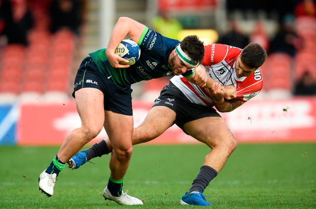 Tom Daly of Connacht is tackled by Matt Banahan of Gloucester. Photo by Ramsey Cardy/Sportsfile