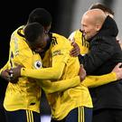 Arsenal's Ainsley Maitland-Niles and Nicolas Pepe celebrate alongside Arsenal interim manager Freddie Ljungberg