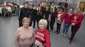 Under threat: Manager Hilda Hamilton and director Lily Greene with youth workers at a Christmas party for the elderly at the Killinarden Community Centre. Photo: Arthur Carron