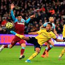 Arsenal's Pierre-Emerick Aubameyang scores his side's third goal during their victory against West Ham. Photo: Adam Davy/PA Wire