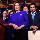 United front: Speaker of the House Nancy Pelosi and fellow Democrats on Capitol Hill yesterday. Photo: Getty Images