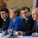 Ukrainian President Volodymyr Zelensky (left), with German Chancellor Angela Merkel, French President Emmanuel Macron and Russian President Vladimir Putin at a press conference at the Elysee Palace, Paris. Photo: Getty Images