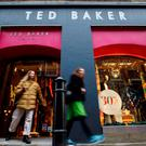 Pedestrians walk past a Ted Baker clothing store in London (Photo: AFP via Getty Images)