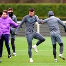 Irish teenager Troy Parrott warms up during Tottenham's training session yesterday – the Dubliner may make his Champions League debut against Bayern Munich tonight only days after getting his first taste of Premier League action. Photo: PA