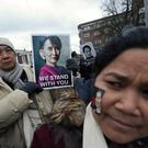 A woman holds a picture of Myanmar's leader Aung San Suu Kyi during a demonstration outside the International Court of Justice (ICJ), on the second day of hearings in a case filed by Gambia against Myanmar alleging genocide against the minority Muslim Rohingya population, in The Hague, Netherlands December 11, 2019. REUTERS/Yves Herman