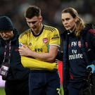 Arsenal's Kieran Tierney is substituted after sustaining a shoulder injury in last Monday's Premier League win over Ham United at the London Stadium