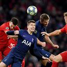 Tottenham Hotspur's Juan Foyth gets the ball cleared ahead of Bayern Munich's Ivan Perisic. Photo: REUTERS/Andreas Gebert