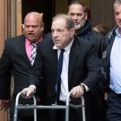 Walk of shame: Harvey Weinstein leaves court in New York with a walking frame after his civil hearing. AP Photo/Mark Lennihan, File