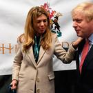 Prime Minister Boris Johnson with partner Carrie Symonds and dog Dilyn at the count for the Uxbridge & Ruislip South constituency in the 2019 General Election Stefan Rousseau/PA Wire