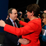 The DUP's Nigel Dodds is embraced by leader Arlene Foster after losing the Belfast North seat. Liam McBurney/PA Wire