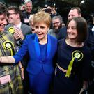 First Minister Nicola Sturgeon celebrates with supporters at the SEC Centre in Glasgow during counting for the 2019 General Election. Andrew Milligan/PA Wire