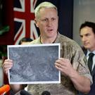 Colonel Rian McKinstry addresses a press conference following the recovery operation to return the victims of the Dec. 9 volcano eruption off the coast of Whakatane New Zealand, Friday, Dec. 13, 2019.(AP Photo/Mark Baker)