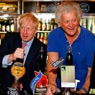 Wetherspoons Chairman Tim Martin (right), with Boris Johnson during a visit to Wetherspoons Metropolitan Bar in London. Photo: Henry Nicholls/PA Wire