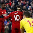 Soccer Football - Premier League - Liverpool v Watford - Anfield, Liverpool, Britain - December 14, 2019 Liverpool's Mohamed Salah celebrates scoring their second goal with teammates REUTERS/Phil Noble EDITORIAL USE ONLY. No use with unauthorized audio, video, data, fixture lists, club/league logos or